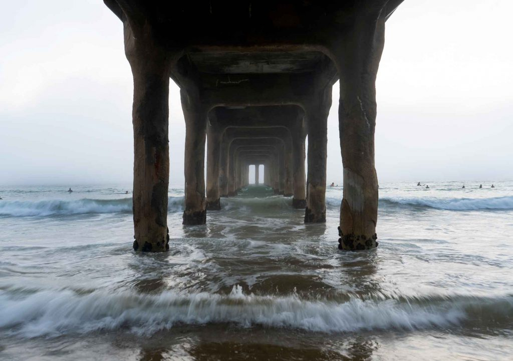 Foggy surfers in the Pacific Ocean - California Cities - Manhattan Beach
